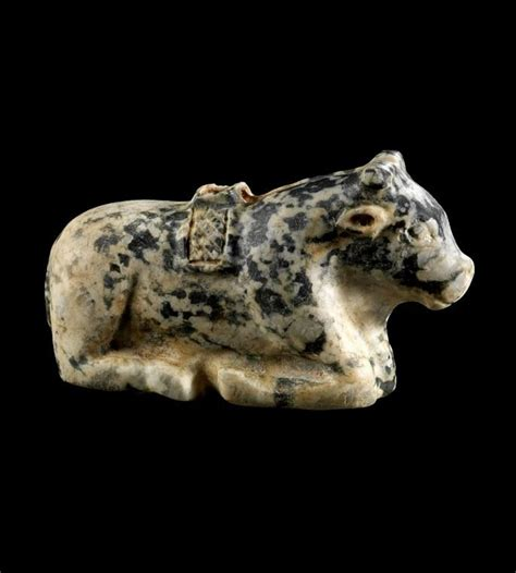 Reclining bull made of speckled stone