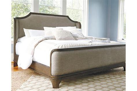 The Larrenton queen upholstered bed gives new meaning to